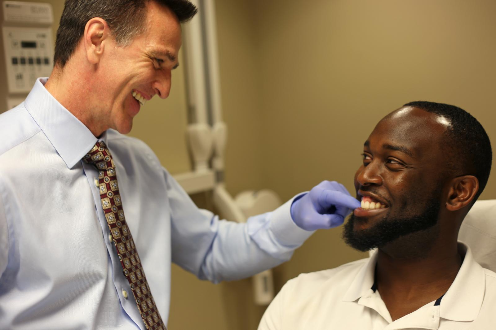 Man getting an orthodontic consultation